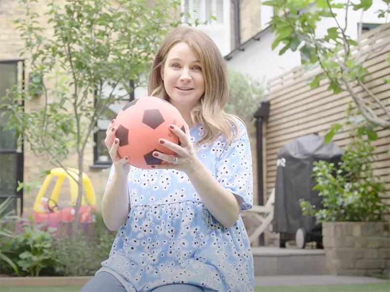 Izzy Judd holding a football
